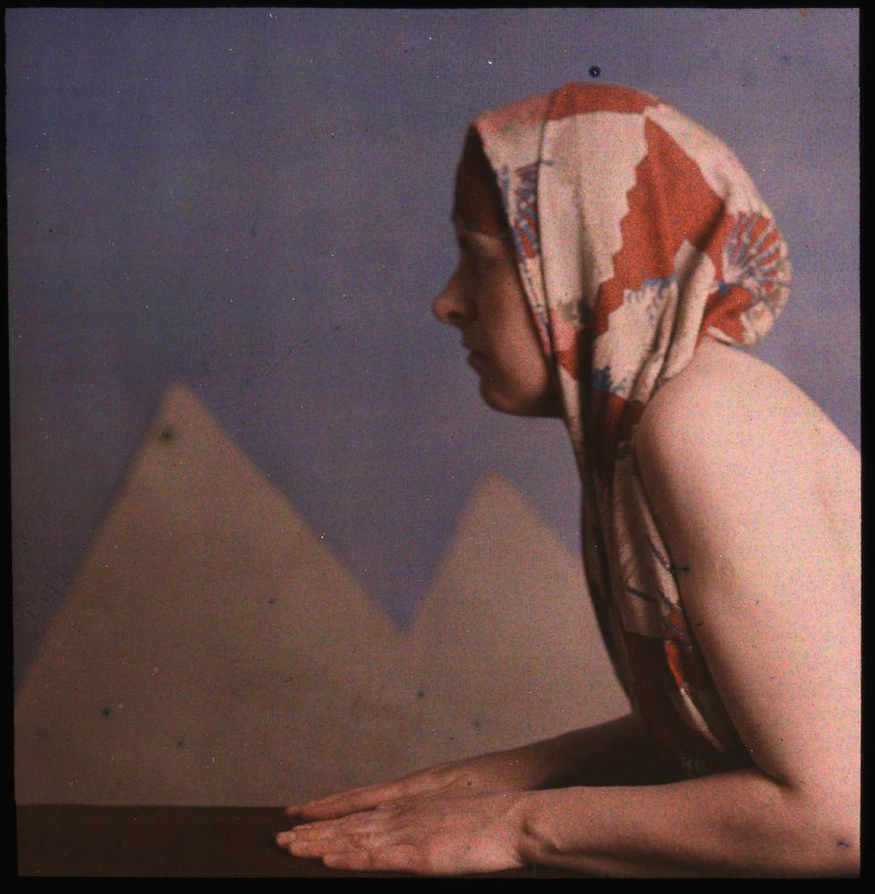 George Eastman Museum  Woman posed as sphinx  Maker: Dr. W. Simon  Title: Woman posed as sphinx  Date: ca. 1910  Medium: color plate, screen (Autochrome) process  Dimensions: Image: 8 x 8 cm Overall: 10 x 12.6 cm